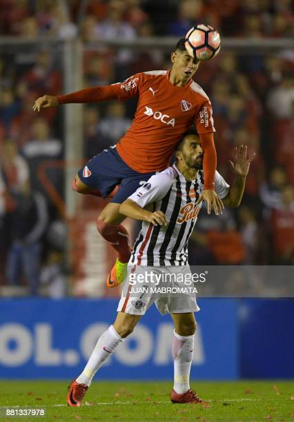Argentina's Independiente defender Alan Franco vies for the ball with Paraguay's Libertad forward Santiago Salcedo during their Copa Sudamericana...