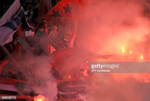 TOPSHOT Argentina's Independiente fans cheer for their team before the Copa Sudamericana 2017 football match against Argentina's Atletico Tucuman at...