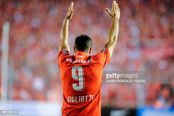 Argentina's Independiente forward Emmanuel Gigliotti celebrates after defeating Paraguay's Libertad during their Copa Sudamericana second leg...