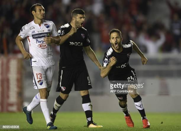 Argentina's Independiente forward Juan Martinez celebrates next to teammate forward Emmanuel Gigliotti after scoring a goal against Paraguay's...