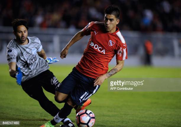 Argentina's Independiente forward Leandro Fernandez vies for the ball with Argentina's Atletico Tucuman goalkeeper Cristian Lucchetti during their...