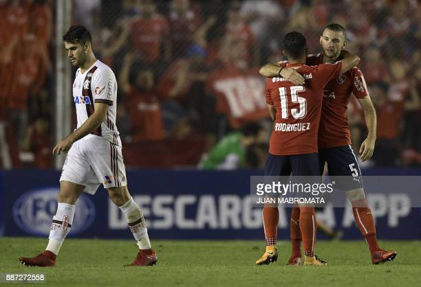 Argentina's Independiente midfielder Diego Rodriguez and midfielder Gaston Silva celebrate after defeating Brazil's Flamengo 21 in the Copa...
