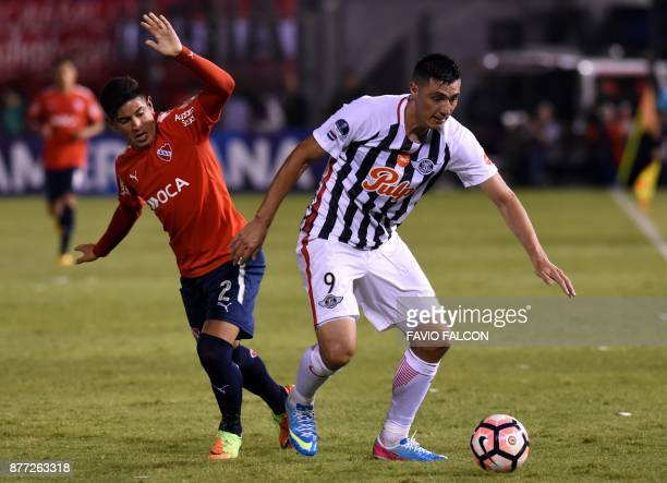 Argentina's Independiente player Alan Franco vies for the ball with Paraguay's Libertad Oscar Cardozo during their Copa Sudamericana first leg...