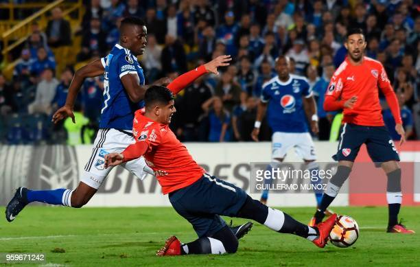 Argentina's Independiente player Alan Franco vies for the ball with Colombian Millonarios Jader Valencia players during their Copa Libertadores...