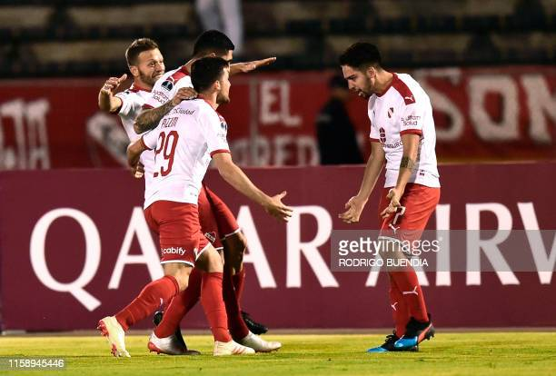 Argentinas Independiente player Martin Benitez celebrates with teammates after scoring against Ecuador's Universidad Catolica during their Copa...
