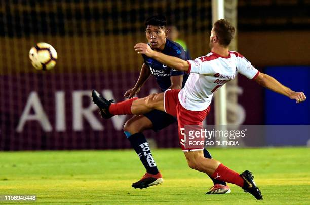 Argentinas Independiente player Nicolas Domingo vies for the ball with Ecuadors Universidad Catolica player Bruno Vides during their Copa...