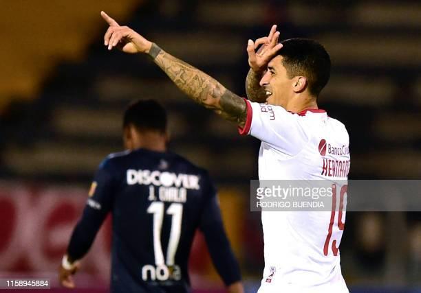 Argentinas Independiente player Pablo Hernandez celebrates his goal against Ecuador's Universidad Catolica during their Copa Sudamericana football...