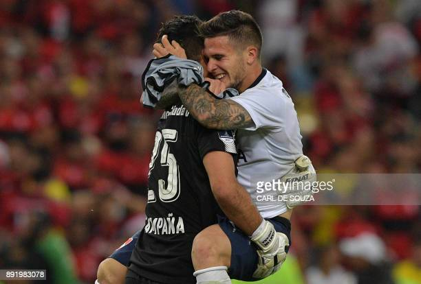 Argentina's Independiente players Fabricio Bustos and Martin Campana celebrate after winning their 2017 Sudamericana Cup football final against...