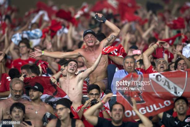 Argentina's Independiente supporters celebrate their team's goal against Brazil's Flamengo during the 2017 Sudamericana Cup Final match at the...