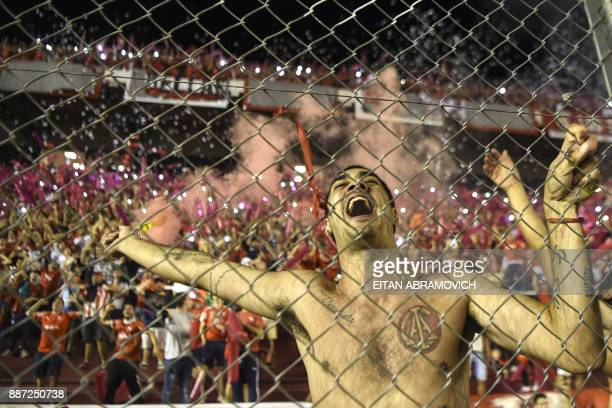 TOPSHOT Argentina's Independiente supporters cheer during the Copa Sudamericana first leg football final against Brazil's Flamengo at Libertadores de...