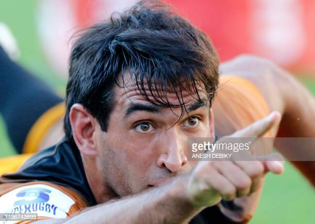 Argentina's Jaguares centre Matias Orlando celebrates scoring his first try during the Super Rugby match between Sharks and Jaguares at The Kings...
