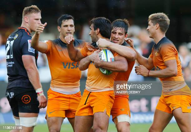 Argentina's Jaguares centre Matias Orlando celebrates with teammates after scoring a try during the Super Rugby match between Sharks and Jaguares at...