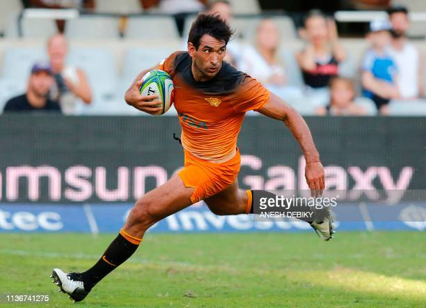 Argentina's Jaguares centre Matias Orlando runs with the ball during the Super Rugby match between Sharks and Jaguares at The Kings Park Rugby...