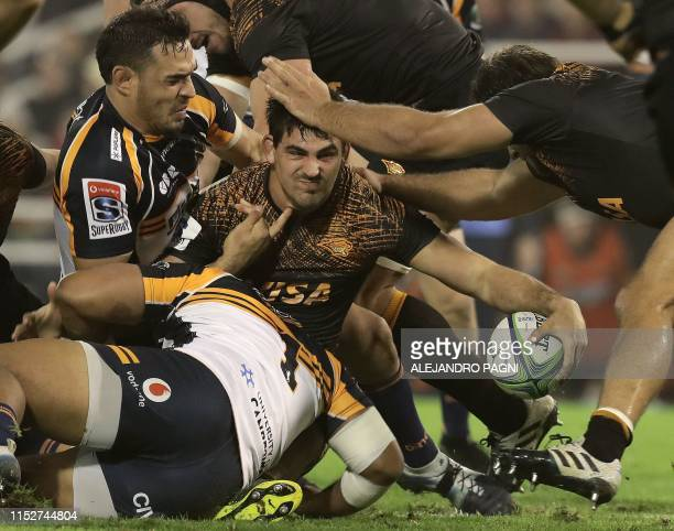 Argentina's Jaguares flanker Pablo Matera vies for the ball with Australia's Brumbies lock Rory Arnold during their Super Rugby semifinal match at...