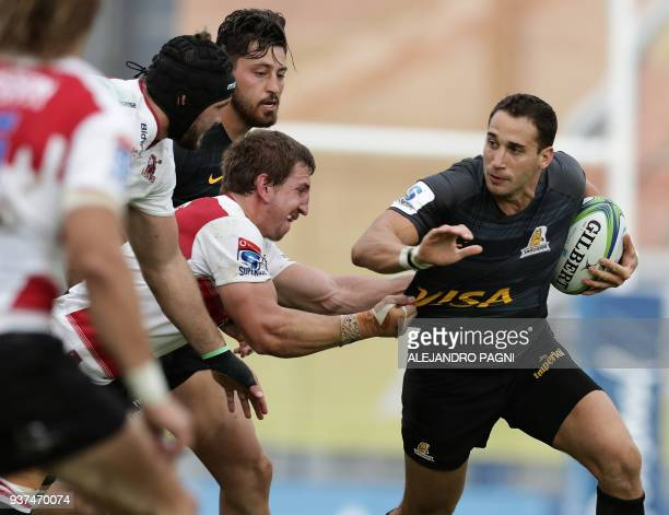 Argentina's Jaguares fullback Joaquin Tuculet vies for the ball with South Africa's Lions N8 Rohan Janse Van Rensburg during their Super Rugby match...