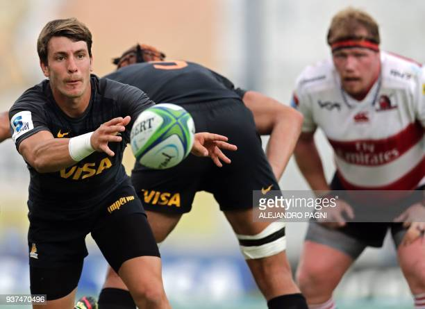 Argentina's Jaguares half scrum Gonzalo Bertranou passes the ball during their Super Rugby match South Africa's Lions at Jose Amalfitani stadium in...