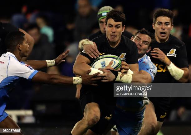 Argentina's Jaguares half scrum Gonzalo Bertranou runs with the ball during their Super Rugby match against South Africa's Bulls at Jose Amalfitani...