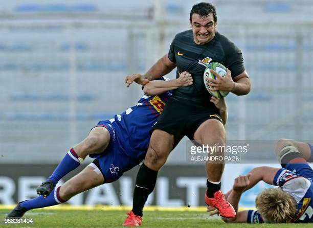 Argentina's Jaguares hooker Agustin Creevy is tackled by South Africa's Stormers centre Justin Phillips during their Super Rugby match at Jose...