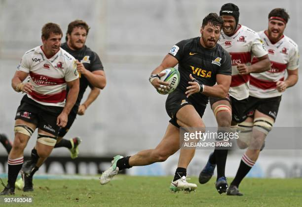 Argentina's Jaguares N8 Javier Ortega Desio runs to score a try against South Africa's Lions during their Super Rugby match at Jose Amalfitani...