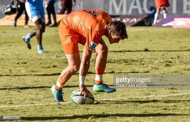 Argentina's Jaguares scrumhalf Gonzalo Bertanou scores his try during the Super Rugby match between SouthAfrica's Bulls and the Jaguars at the Loftus...