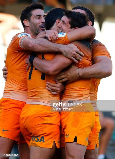 Argentina's Jaguares wing Matias Moroni celebrates after scoring a try during the Super Rugby match between Sharks and Jaguares at The Kings Park...