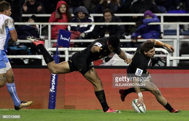 Argentina's Jaguares wing Sebastian Cancelliere scores a try against South Africa's Bulls during their Super Rugby match at Jose Amalfitani stadium...