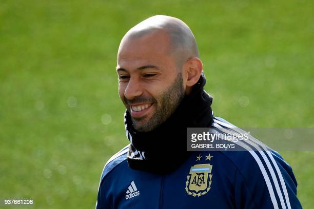 Argentina's Javier Mascherano smiles during a training session in Madrid on March 25 2018 ahead of an international friendly football match between...