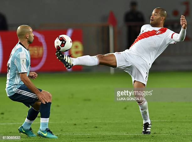 Argentina's Javier Mascherano vies for the ball with Peru's Alberto Rodriguez during their Russia 2018 World Cup qualifier football match in Lima on...