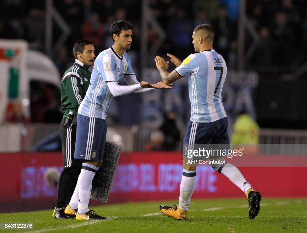 Argentina's Javier Pastore replaces Argentina's Mauro Icardi during their 2018 World Cup qualifier football match in Buenos Aires on September 5 2017...