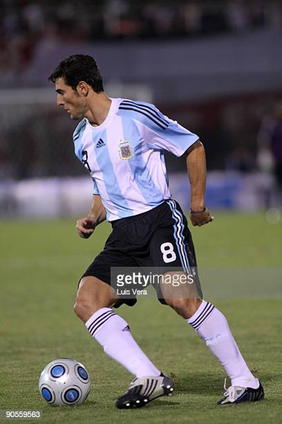 Argentina's Javier Zanetti conducts the ball against Paraguay during their 2010 FIFA World Cup qualifier at the Defensores del Chaco Stadium on...