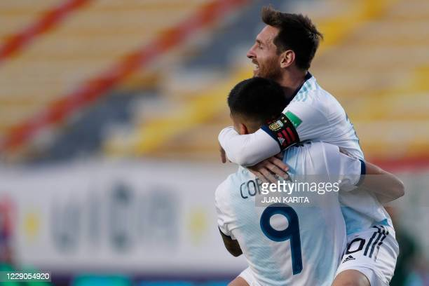 Argentina's Joaquin Correa celebrates with teammate Lionel Messi after scoring against Bolivia during their 2022 FIFA World Cup South American...