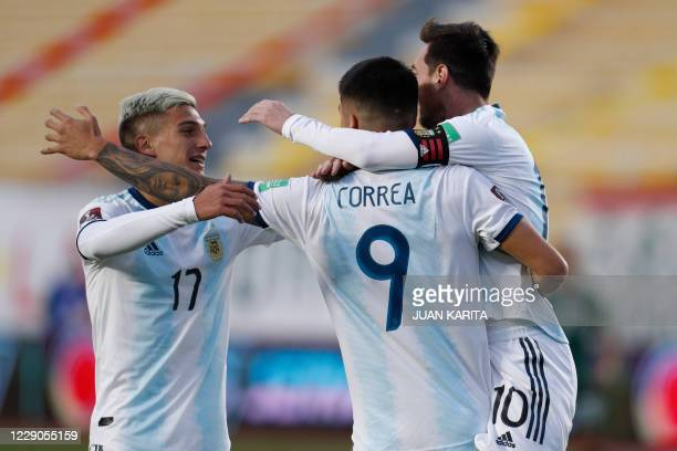 Argentina's Joaquin Correa celebrates with teammates Lionel Messi and Nicolas Dominguez after scoring against Bolivia during their 2022 FIFA World...