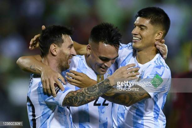 Argentina's Joaquin Correa celebrates with teammates Lionel Messi and Lautaro Martinez after scoring against Venezuela during their South American...
