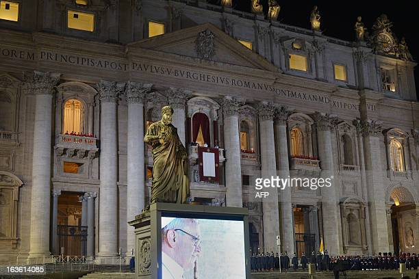 Argentina's Jorge Bergoglio, elected Pope Francis I appears at the window of St Peter's Basilica's balcony, near a statue of St Peter, after being...