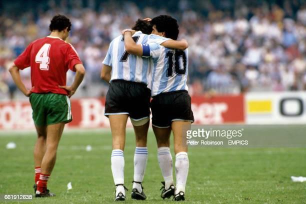 Argentina's Jorge Burruchaga celebrates his goal with teammate Diego Maradona as Bulgaria's Peter Petrov trudges back to his position