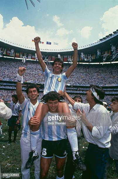 Argentina's Jorge Burruchaga is carried by Nestor Clausen after scoring the World Cup Final winning goal against West Germany at the Azteca Stadium...
