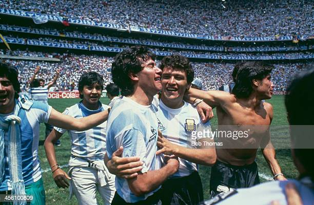 Argentina's Jorge Burruchaga is congratulated by Nestor Clausen after scoring the World Cup Final winning goal against West Germany at the Azteca...