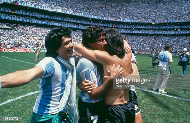 Argentina's Jorge Burruchaga is congratulated by players after scoring the World Cup Final winning goal against West Germany at the Azteca Stadium...
