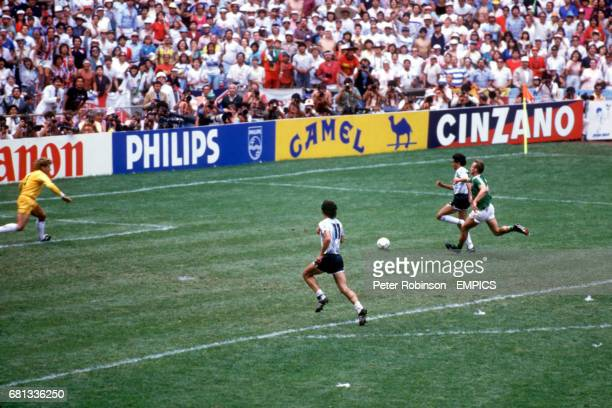 Argentina's Jorge Burruchaga outpaces West Germany's HansPeter Briegel to score the winning goal with teammate Jorge Valdano in support past West...