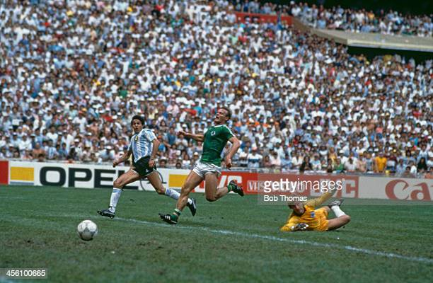 Argentina's Jorge Burruchaga shoots the World Cup Final winning goal past West Germany's Hans Peter Briegel and Harald Schumacher at the Azteca...