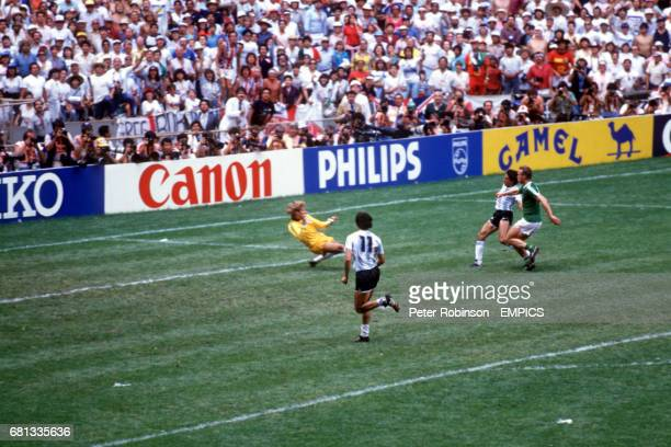 Argentina's Jorge Burruchaga slides the ball past West Germany goalkeeper Harald Schumacher to score the winning goal watched by teammate Jorge...