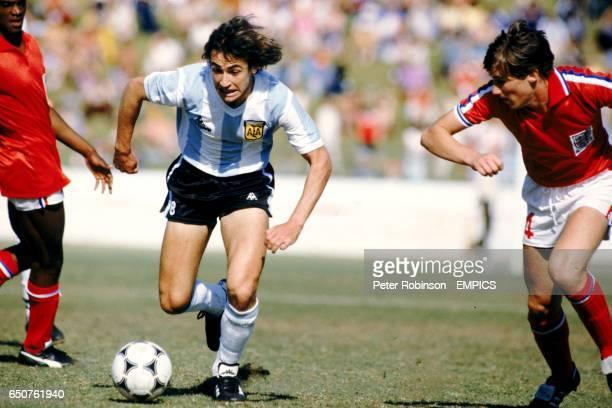Argentina's Jorge Burruchaga takes on England's Stewart Robson