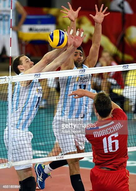 Argentina's Jose Luis Gonzalez and Sebastian Sole block during the FIVB World Championships match between Argentina and France on Septembert 10 2014...