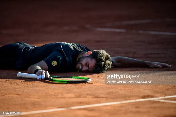 Argentina's Juan Ignacio Londero celebrates after winning against France's Corentin Moutet at the end of their men's singles third round match on day...