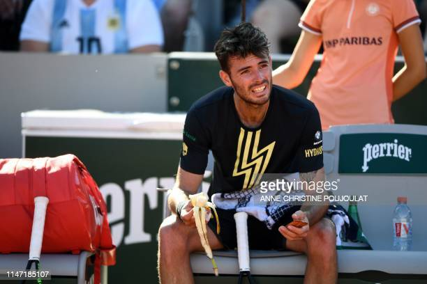 Argentina's Juan Ignacio Londero eats during a break during his men's singles third round match against France's Corentin Moutet on day six of The...