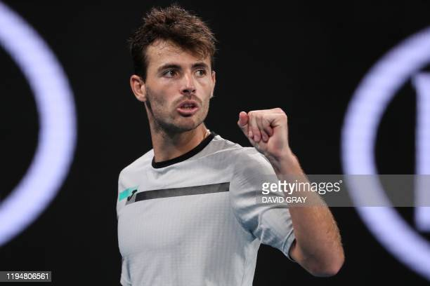 Argentina's Juan Ignacio Londero reacts after a point against Bulgaria's Grigor Dimitrov during their men's singles match on day one of the...