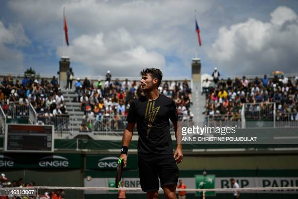 Argentina's Juan Ignacio Londero reacts as he plays against France's Richard Gasquet during their men's singles second round match on day four of The...