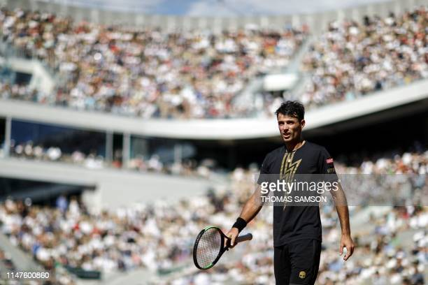 Argentina's Juan Ignacio Londero reacts as he plays against Spain's Rafael Nadal during their men's singles fourth round match on day eight of The...