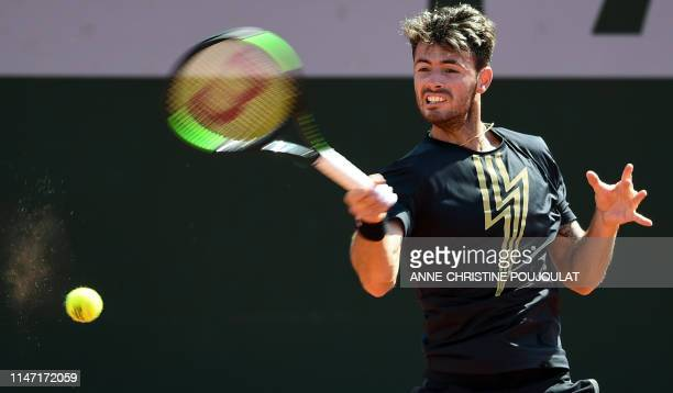 Argentina's Juan Ignacio Londero returns the ball to France's Corentin Moutet during their men's singles third round match on day six of The Roland...