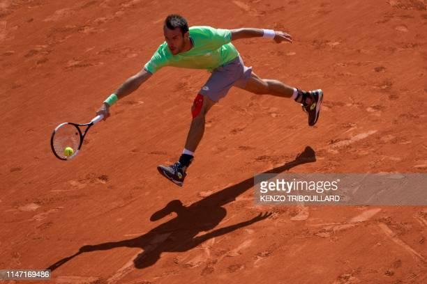 Argentina's Juan Ignacio Londero returns the ball to France's Nicolas Mahut during their men's singles third round match on day six of The Roland...